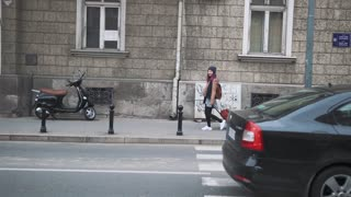woman walking with suitcase in the european street