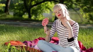 woman with lollipop and headphones