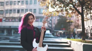 Young beautiful girl with electric guitar