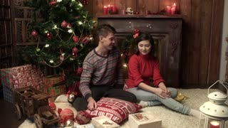 young couple Christmas wrapping xmas gifts