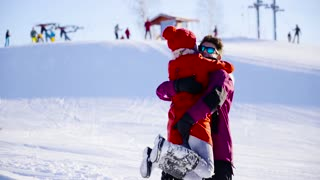 Young Couple In Alpine hugging