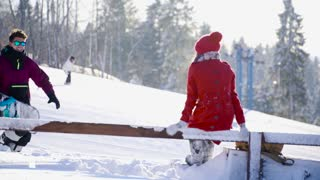 Young couple in love hugging and posing ski resort