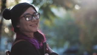 young smiling woman-student in glasses