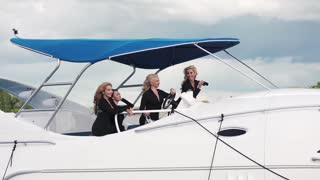 Young woman divers on a boat