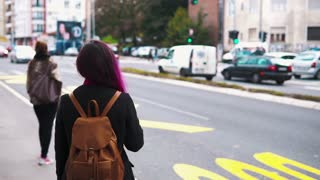 Young woman waiting for a bus at the bus stop