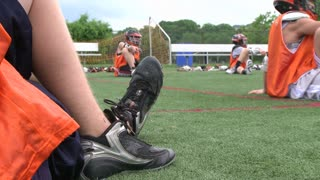 Boys Lacrosse players sitting on the field(2 of 3)