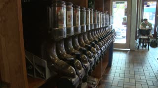 Coffee shop with coffee bean dispensers along wall(1 of 2)