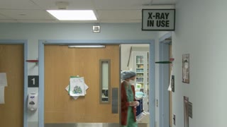 Doctor walking into operating room (1 of 2)