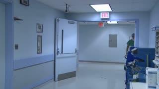 Doctor walks down hallway