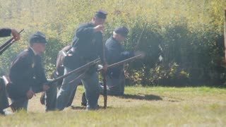 Enactors shooting guns (1 of 3)