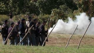 Enactors shooting guns (2 of 3)