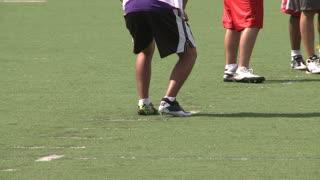 High school Football team practicing receiving (1 of 5)