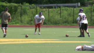 High school Football team practicing receiving (4 of 5)