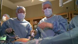 Surgical team performing laparoscopic procedure (2 of 7)
