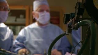 Surgical team performing laparoscopic procedure (5 of 7)