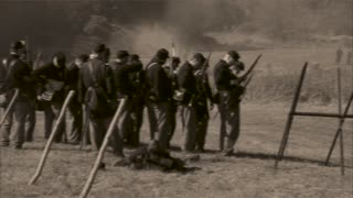 Vintage combatants firing arms (1 of 2)