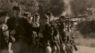 Vintage combatants firing arms (2 of 2)