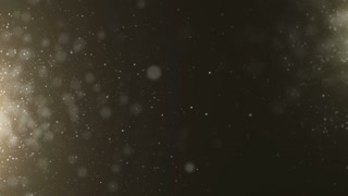 Gold particles bokeh glitter awards dust abstract background loop