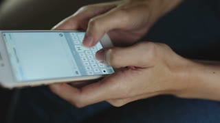 closeup of woman Texting on a touchscreen