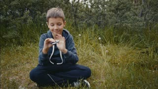 a boy plays with fidget spinner