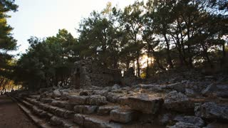 Antique ruins of an ancient fortress at sunset