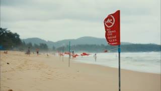 red danger flag on the beach