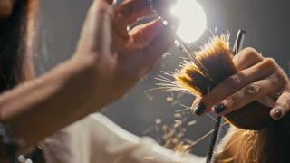 scissors cut hair close-up