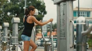 woman on training equipment outdoor