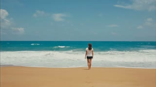 Woman Watching Ocean Waves
