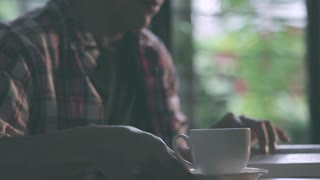 Man reading a book and drinking coffee, Video HD 1080