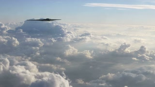 B-2 Stealth Bomber Flying Pass Above Clouds
