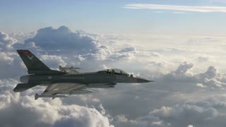 F-16 Fighter Jet Cruising Over Evening Clouds_C_UHD.mov