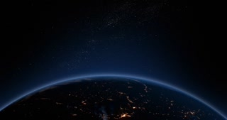 Earth's atmosphere from space with the sun's light starting to rise as the earth turns.