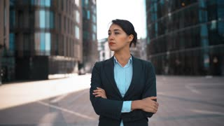 4k. Portrait of young confident sexy caucasian business person with arms crossed, looking at camera and smiling. Pomade, brownhair, lady, businesswoman. Success concept. formal suit and shirt. Modern