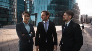4k. POV. Three Young attractive businesspeople Businessman and businesswoman agree with You and applause. Ovations. Approvement. Formal suits. Teal and orange sunset style. Wide shot. Male, Female