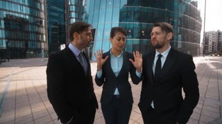 4k. POV. Three Young attractive businesspeople, Businessman and businesswoman,agree with Your idea and opinion. Shake head. Approvement. Formal suits. Teal and orange sunrise style. Wide shot. Male