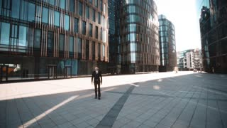 4k. UHD. POV Young successful serious attractive businessman in deal formal suit and tie with beard and mustache comes to You and shake your hand. Teal and orange wide shot. Sunset. Glass Business