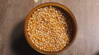 Pop corn pouring into a bowl