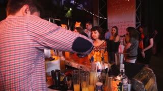 SAINT-PETERSBURG - DEC 25: barman making a cocktail at the bar