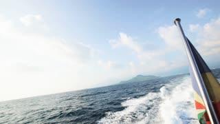 Seychelles flag waving on the boat