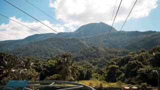 4k UHD Funicular with a view of Puerto Plata beautifull epic mountain with green trees blue sky clouds Dominican Republic
