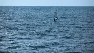 4k ultra hd. Single alone man have active relax with windsurfing. Black Sea. Clean blue azur aqua and water with little waves