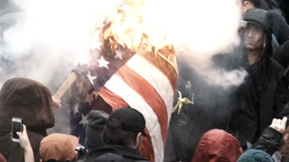 Protesters Burning The American Flag
