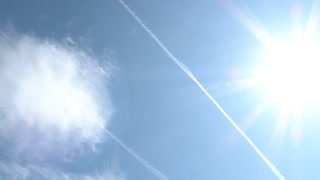 Airplane Fly Over Sun And Contrails
