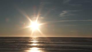 Bright Sun Setting Over Ocean Horizon