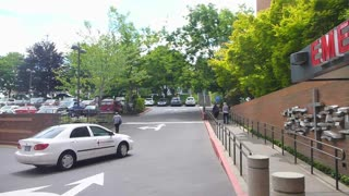 Car Drives Outside Emergency Room At Hospital