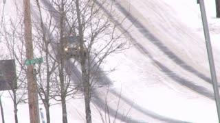 Cars Driving On Dangerous Snowy Roads