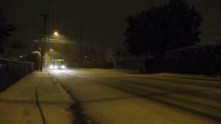 City Bus Driving During Snow Storm At Night