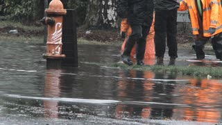 City Workers On Flooded Streets After Storm