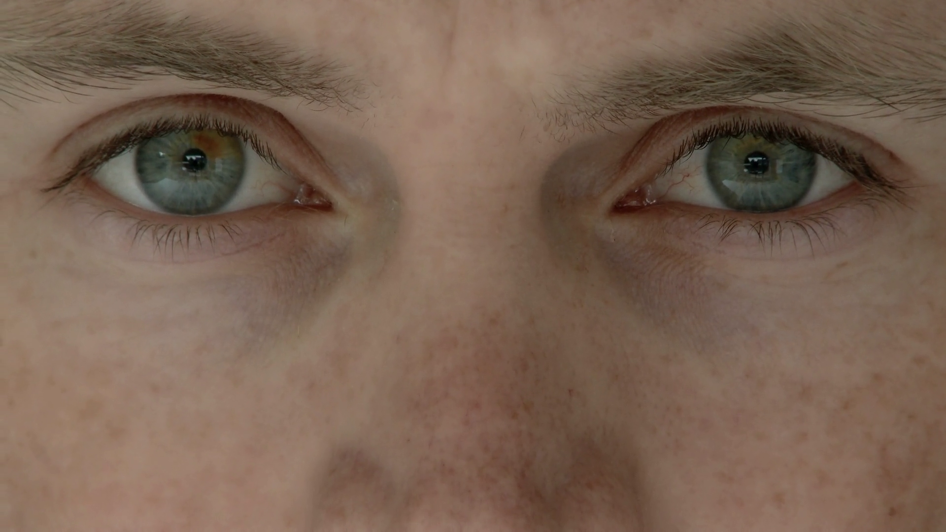 Close up of mans eyes looking up and into camera lens